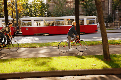 Vienna cyclists and tram