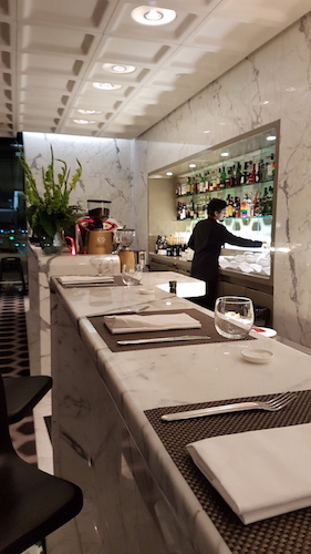 A full service bar is avaialble and also provides an informal dining option within the Qantas First Class Lounge.