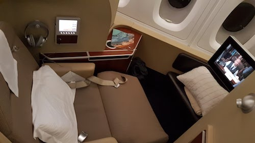 The seat swivels to face the ottoman and screen.
