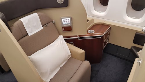 The seat in first class swivels to face the ottoman.