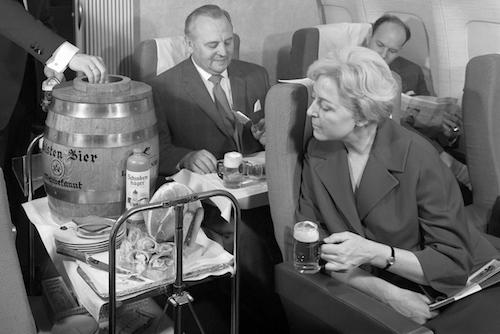 Business Class passengers enjoying the Oktoberfest keg in the 1960s