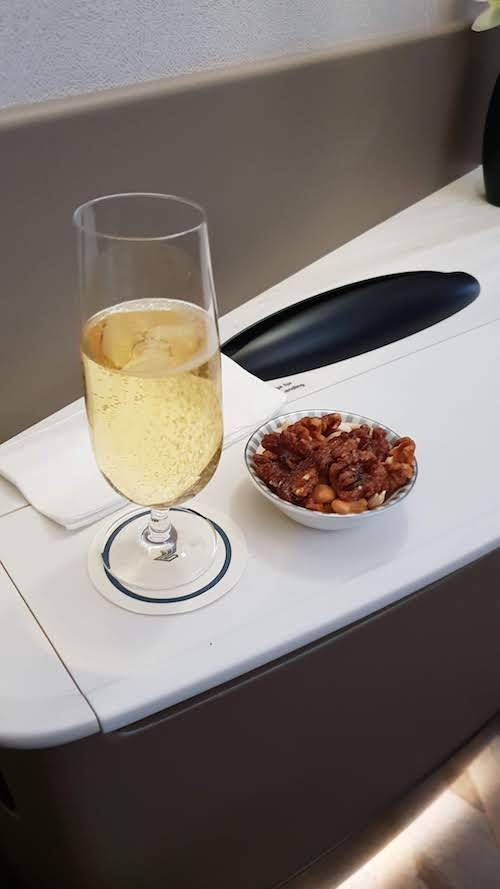 Champagne and Warm nuts pre-takeoff