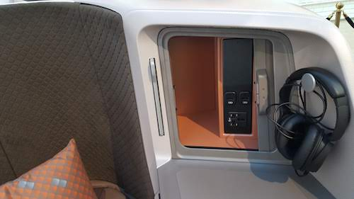 Singapore Airlines Storage compartment and headphone hook.