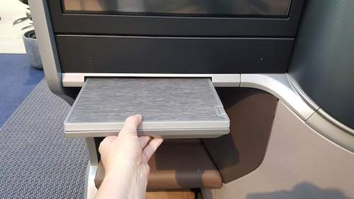 Singapore Airlines A350 Dining table slides out from underneath the entertainment screen