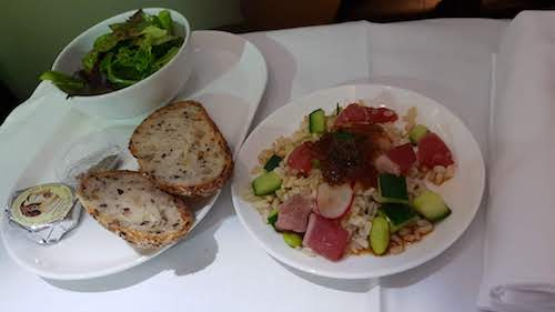Salad of seared tuna with brown rice, edamame, cucumber, radish and sesame soy dressing.