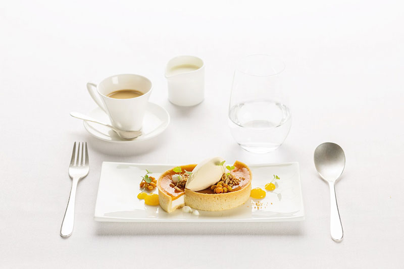 Dessert in First Class: Tart with sea buckthorn jelly and sour cream